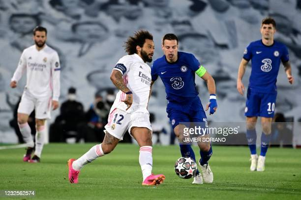 Real Madrid's Brazilian defender Marcelo challenges Chelsea's Spanish defender Cesar Azpilicueta during the UEFA Champions League semi-final first...