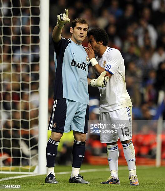 Real Madrid's Brazilian defender Marcelo chats with Real Madrid's goalkeeper and captain Iker Casillas during the Spanish King's Cup football match...