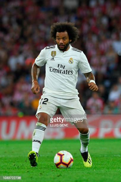 Real Madrid's Brazilian defender Marcelo controls the ball during the Spanish league football match between Athletic Club Bilbao and Real Madrid CF...