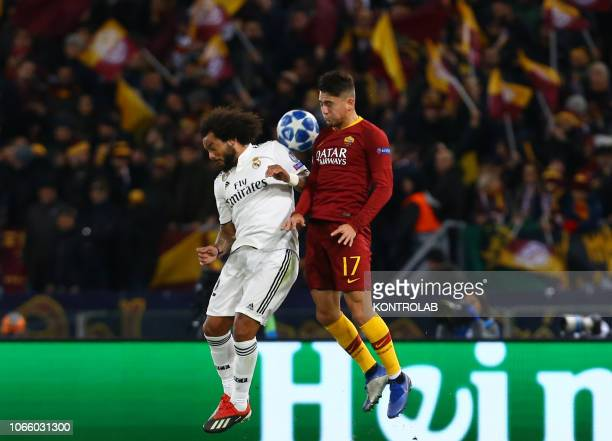 Real Madrid's Brazilian defender Marcelo fights for the ball with Roma's Turkish striker Cengiz Under during the UEFA Champions League football match...