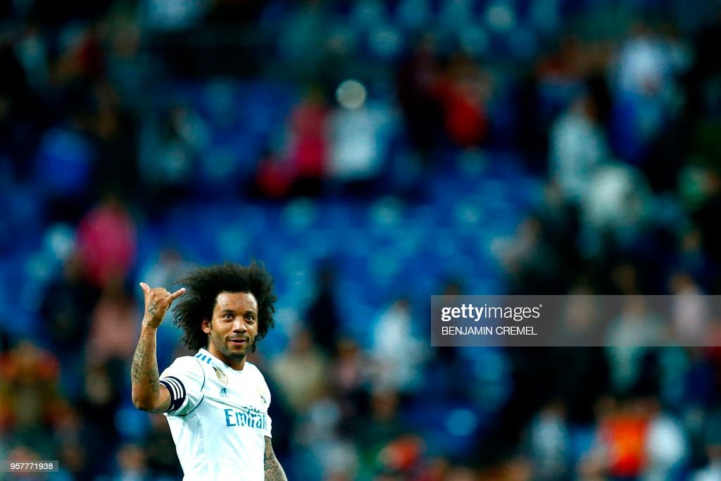 TOPSHOT - Real Madrid's Brazilian defender Marcelo gestures during the Spanish league football match between Real Madrid and Celta Vigo at the Santiago Bernabeu Stadium in Madrid on May 12, 2018.