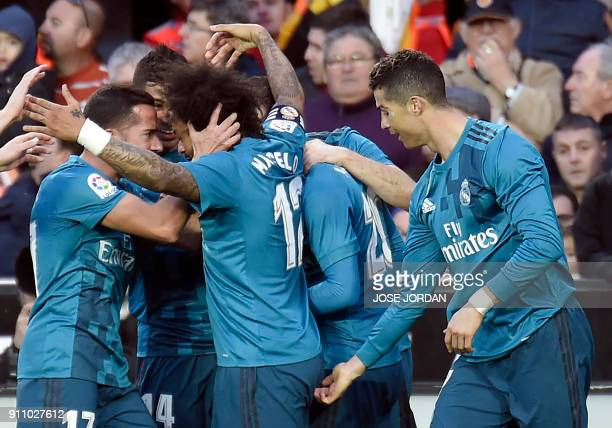 Real Madrid's Brazilian defender Marcelo is congratulated by Real Madrid's Portuguese forward Cristiano Ronaldo after scoring a goal during the...