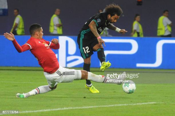 Real Madrid's Brazilian defender Marcelo kicks the ball during the UEFA Super Cup football match between Real Madrid and Manchester United on August...