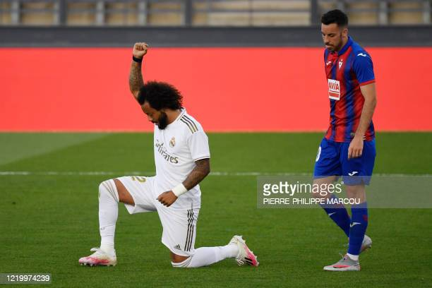Real Madrid's Brazilian defender Marcelo kneels on the field to celebrate his goal during the Spanish League football match between Real Madrid CF...