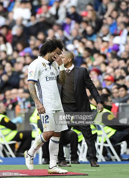 Real Madrid's Brazilian defender Marcelo leaves the pitch during the Spanish league football match Real Madrid CF vs Malaga CF at the Santiago...