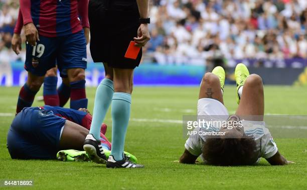 Real Madrid's Brazilian defender Marcelo lies on the field during the Spanish Liga football match Real Madrid vs Levante at the Santiago Bernabeu...