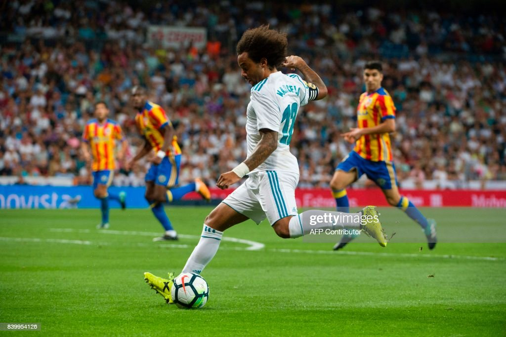 Real Madrid's Brazilian defender Marcelo prepares to kick the ball during the Spanish league football match Real Madrid CF vs Valencia CF at the Santiago Bernabeu stadium in Madrid on August 27, 2017. /
