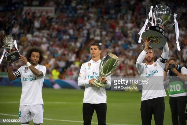 Real Madrid's Brazilian defender Marcelo Real Madrid's Portuguese forward Cristiano Ronaldo and Real Madrid's defender Sergio Ramos hold respectively...