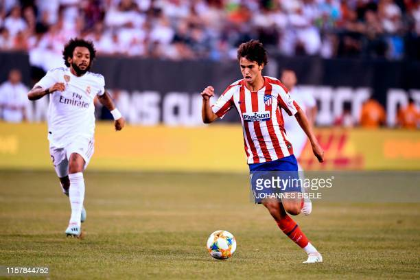 Real Madrid's Brazilian defender Marcelo runs after Atletico Madrid's Portuguese midfielder Joao Felix as he controls the ball during their 2019...