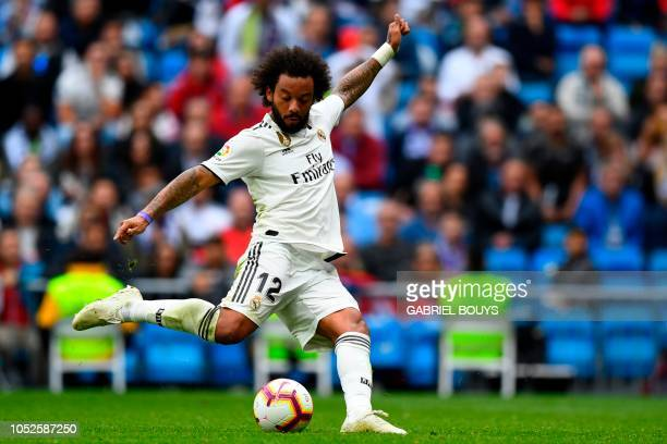 Real Madrid's Brazilian defender Marcelo scores during the Spanish league football match Real Madrid CF against Levante UD at the Santiago Bernabeu...