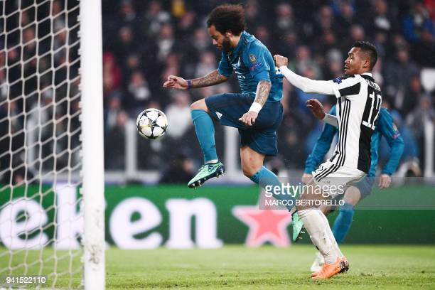 Real Madrid's Brazilian defender Marcelo scores his team's third goal next to Juventus' Brazilian defender Alex Sandro during the UEFA Champions...