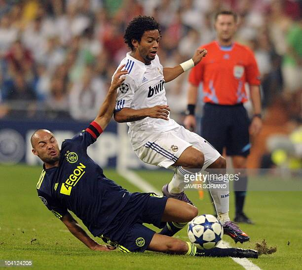 Real Madrid's Brazilian defender Marcelo vies for the ball with Ajax's miedfielder Demy de Zeeuw during their Champions league group G football match...