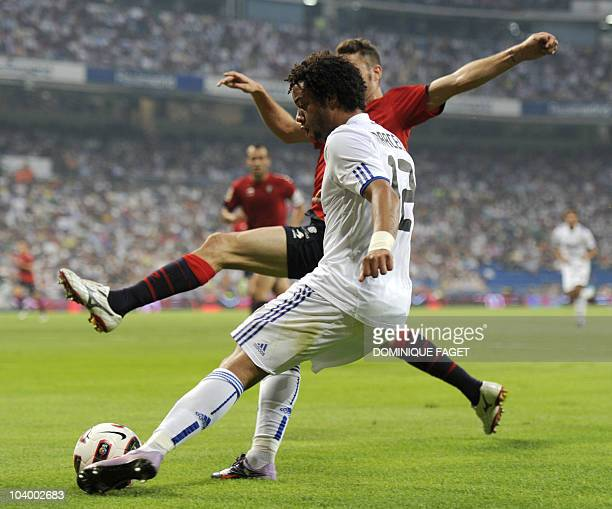 Real Madrid's Brazilian defender Marcelo vies for the ball with during the Spanish league football match Real Madrid against Osasuna at the Santiago...