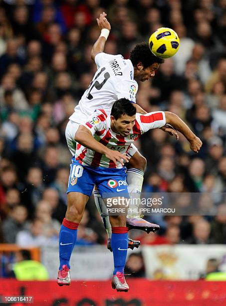 Real Madrid's Brazilian defender Marcelo vies with Atletico Madrid's Argentinian forward Sergio Kun Aguero during their Spanish League football match...