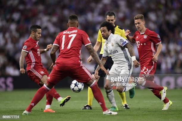 Real Madrid's Brazilian defender Marcelo vies with Bayern players during the UEFA Champions League quarterfinal second leg football match Real Madrid...