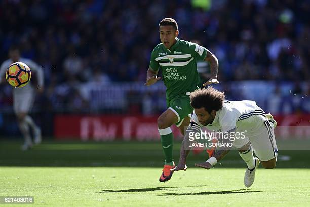 Real Madrid's Brazilian defender Marcelo vies with Leganes's Venezuelian defender Machis during the Spanish league football match Real Madrid CF vs...
