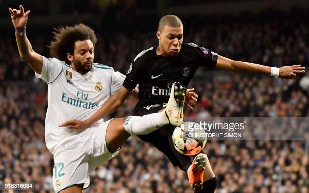 TOPSHOT Real Madrid's Brazilian defender Marcelo vies with Paris SaintGermain's French forward Kylian Mbappe during the UEFA Champions League round...