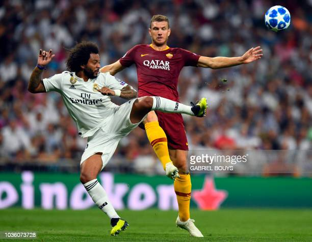 Real Madrid's Brazilian defender Marcelo vies with Roma's Serbian defender Aleksandar Kolarov during the UEFA Champions League group G football match...