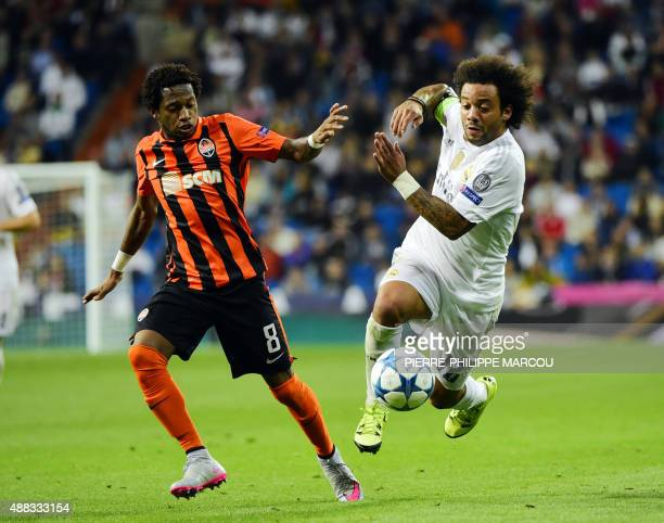 Real Madrid's Brazilian defender Marcelo vies with Shakhtar Donetsk's Brazilian midfielder Fred during the UEFA Champions League group A football...