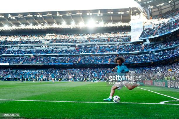 TOPSHOT Real Madrid's Brazilian defender Marcelo warms up before the UEFA Champions League semifinal second leg football match between Real Madrid...