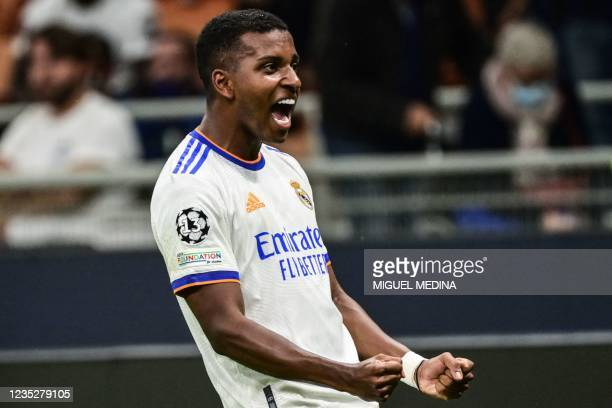 Real Madrid's Brazilian forward Rodrygo celebrates after opening the scoring during the UEFA Champions League Group D football match between Inter...