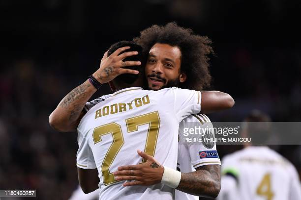 Real Madrid's Brazilian forward Rodrygo celebrates with Real Madrid's Brazilian defender Marcelo after scoring during the UEFA Champions League Group...