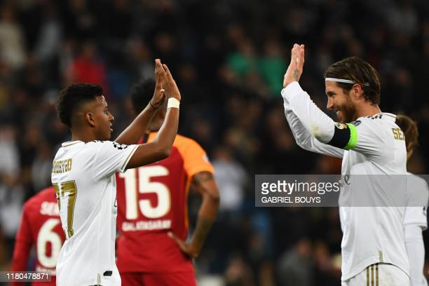 Real Madrid's Brazilian forward Rodrygo celebrates with Real Madrid's Spanish defender Sergio Ramos after scoring during the UEFA Champions League...
