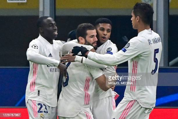 Real Madrid's Brazilian forward Rodrygo celebrates with Real Madrid's French defender Ferland Mendy, Real Madrid's Spanish defender Nacho Fernandez...