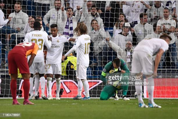 Real Madrid's Brazilian forward Rodrygo celebrates with teammates after scoring during the UEFA Champions League Group A football match between Real...