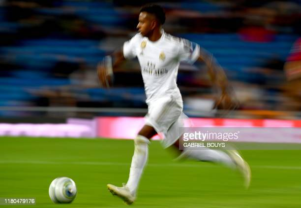 Real Madrid's Brazilian forward Rodrygo controls the ball during the UEFA Champions League Group A football match between Real Madrid and Galatasaray...