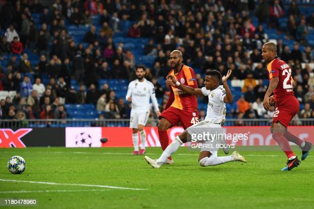 Real Madrid's Brazilian forward Rodrygo scores during the UEFA Champions League Group A football match between Real Madrid and Galatasaray at the...