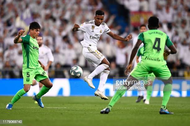 Real Madrid's Brazilian forward Rodrygo vies with Leganes' Argentinian defender Jonathan Silva and Leganes' Nigerian defender Kenneth Omeruo during...