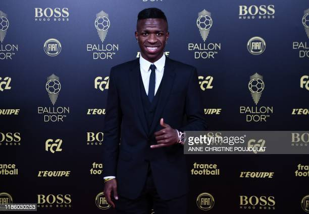 Real Madrid's Brazilian forward Vinicius Junior arrives to attend the Ballon d'Or France Football 2019 ceremony at the Chatelet Theatre in Paris on...