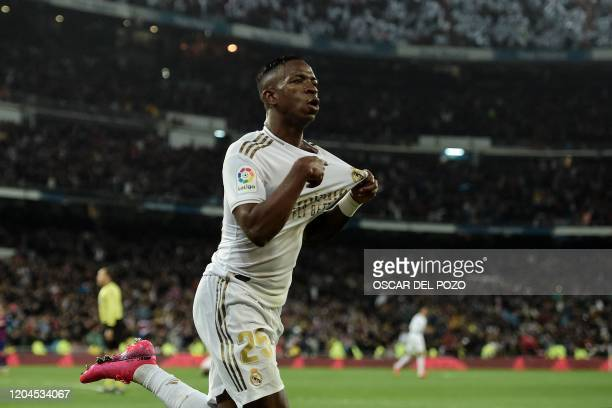 Real Madrid's Brazilian forward Vinicius Junior celebrates a goal during the Spanish League football match between Real Madrid and Barcelona at the...