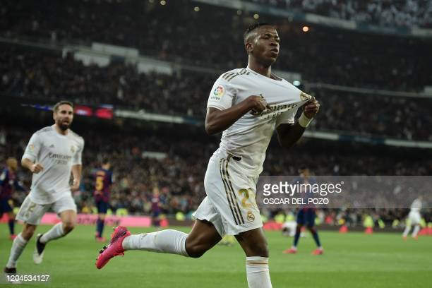 TOPSHOT Real Madrid's Brazilian forward Vinicius Junior celebrates a goal during the Spanish League football match between Real Madrid and Barcelona...