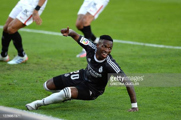 Real Madrid's Brazilian forward Vinicius Junior celebrates after scoring a goal during the Spanish League football match between Sevilla and Real...