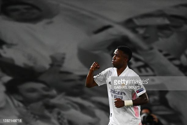 Real Madrid's Brazilian forward Vinicius Junior celebrates after scoring his team's third goal during the UEFA Champions League first leg...