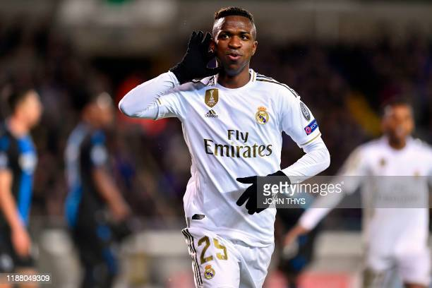 Real Madrid's Brazilian forward Vinicius Junior celebrates after scoring their second goal during the UEFA Champions League Group A football match...