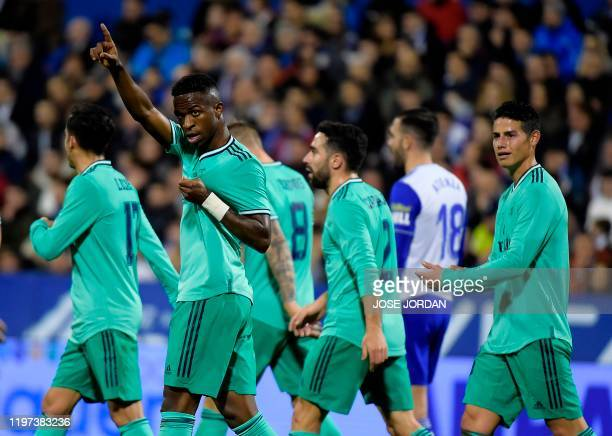 Real Madrid's Brazilian forward Vinicius Junior celebrates after scoring during the Copa del Rey football match between Zaragoza and Real Madrid CF...