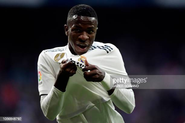 Real Madrid's Brazilian forward Vinicius Junior celebrates Valladolid's own goal during the Spanish league football match between Real Madrid CF and...