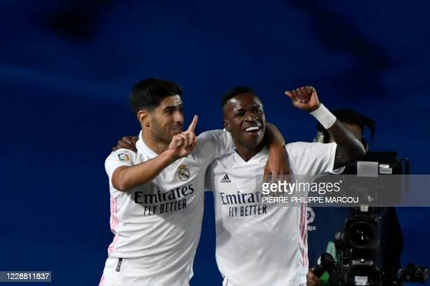 Real Madrid's Brazilian forward Vinicius Junior celebrates with Real Madrid's Spanish midfielder Marco Asensio after scoring during the Spanish...