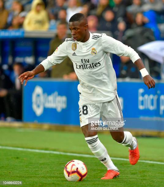 Real Madrid's Brazilian forward Vinicius Junior controls the ball during the Spanish league football match between Deportivo Alaves and Real Madrid...