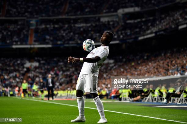 TOPSHOT Real Madrid's Brazilian forward Vinicius Junior controls the ball during the Spanish league football match between Real Madrid CF and CA...