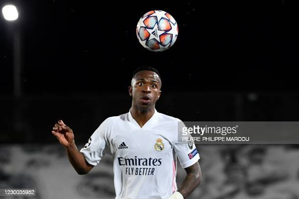 Real Madrid's Brazilian forward Vinicius Junior heads the ball during the UEFA Champions League group B football match between Real Madrid and...