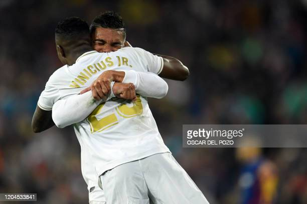 Real Madrid's Brazilian forward Vinicius Junior is congratulated by Real Madrid's Brazilian midfielder Casemiro during the Spanish League football...