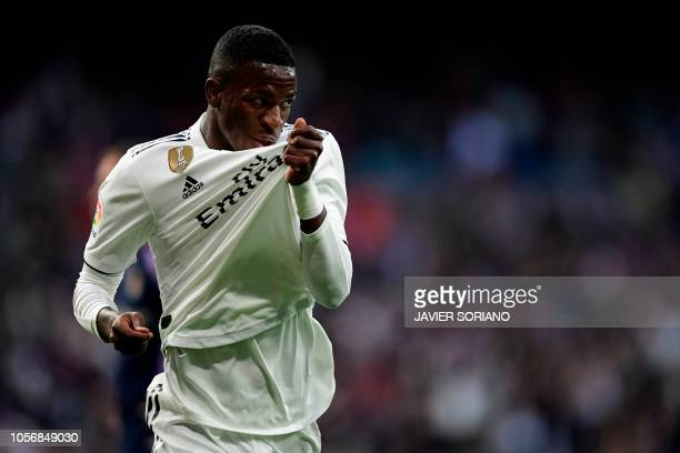Real Madrid's Brazilian forward Vinicius Junior kisses his jersey's badge to celebrate Valladolid's own goal during the Spanish league football match...