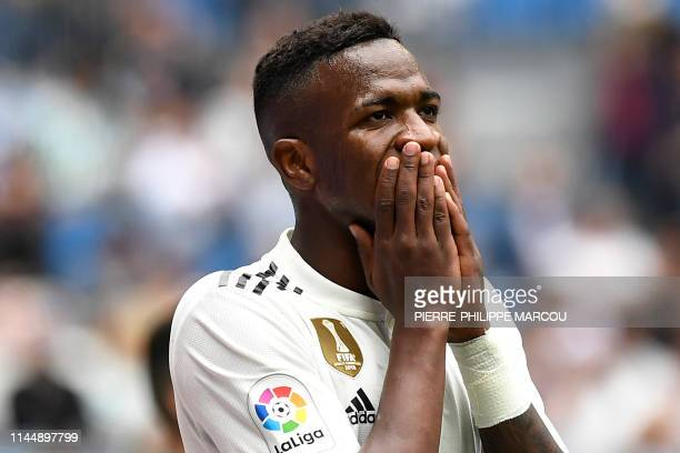Real Madrid's Brazilian forward Vinicius Junior reacts after missing a goal opportunity during the Spanish League football match between Real Madrid...