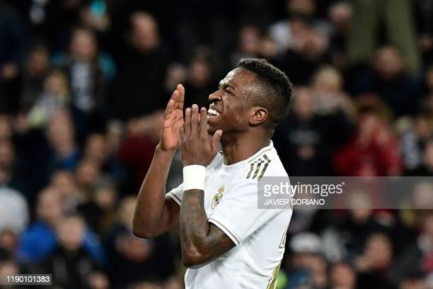 Real Madrid's Brazilian forward Vinicius Junior reacts after missing a goal opportunity during the Spanish league football match Real Madrid CF...