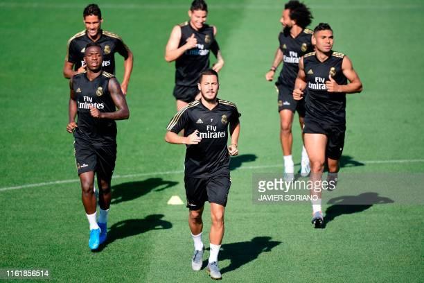 Real Madrid's Brazilian forward Vinicius Junior, Real Madrid's Belgian forward Eden Hazard, Real Madrid's Brazilian midfielder Casemiro Real Madrid's...