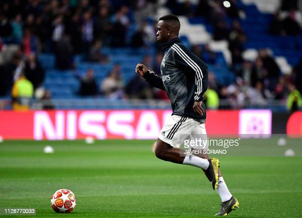Real Madrid's Brazilian forward Vinicius Junior runs for the ball during a warm up before the UEFA Champions League round of 16 second leg football...
